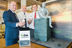 Oak Furniture Land Rotherham Store Manager Jez Groom, Cake Artist Rose Dummer Rotherham Hospice Fundraising Team Leader Anne Giblin and Events Fundraiser Ash Corker enjoy a Celebration Breakfast with Man of Steel at the opening of the Oak Furniture Land Rotherham Store. The cake will be donated to Rotherham Hospice who will use it to help raise funds<br />