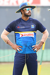 July 6, 2018 - Sri Lanka - Sri Lankan cricket captain Dinesh Chandimal looks on at a practice session at the R.Premadasa Stadium in Colombo on July 6, 2018. Sri Lanka and South Africa will play two Tests, five 50-over One-Day Internationals (ODIs), and one T20 in Sri Lanka between July 12 and August 14. The first Test between South African and Sri Lanka will be played on July 12 at the Galle International Cricket Stadium in Galle (Credit Image: © Lahiru Harshana/Pacific Press via ZUMA Wire)
