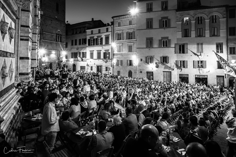 """Contrade """"Selva"""" diner behind Siena's cathedral. 1050 persons to take care of."""
