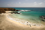 Ribeira de Dom Joao beach is one of the many secluded beaches in Maio island. Accessible only in a four-wheel-drive or by walking, the beach is divided in two bays with emerald water and yellow sand.
