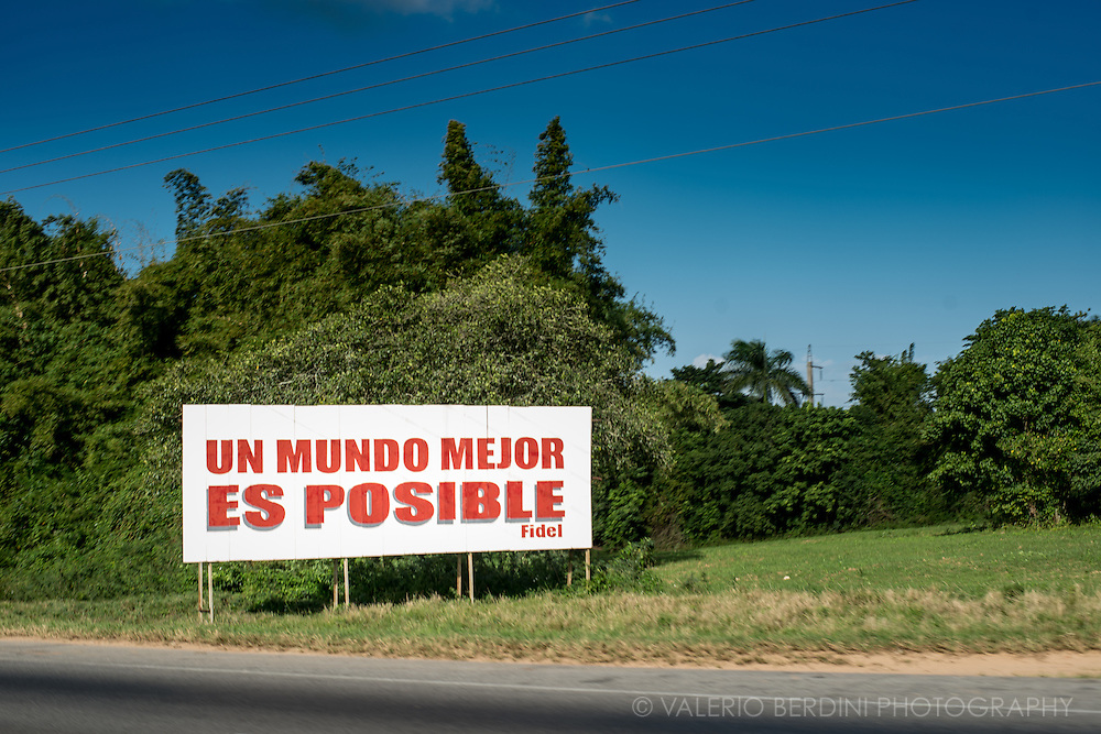 A propaganda poster with a Fidel Castro quote shot on the A4 in Cuba from Pinar Del Rio towards Havana