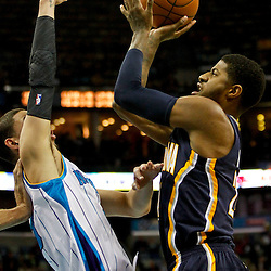 Dec 22, 2012; New Orleans, LA, USA; Indiana Pacers small forward Paul George (24) shoots over New Orleans Hornets shooting guard Austin Rivers (25) during the first quarter of a game at the New Orleans Arena. Mandatory Credit: Derick E. Hingle-USA TODAY Sports