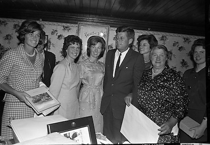 John F. Kennedy in Ireland.  President John F. Kennedy visits the homestead of his great-grandfather at Dunganstown, Co. Wexford and drinks a cup of tea with the present owner of the cottage, a second cousin of the President, Mrs. Mary Ryan (neé Kennedy). Included are Josephine Ryan, Mary Anne Ryan, Eunice Shriver, Matthew McCluskey and Frank Aiken..26.06.1963. The Kennedy Homestead, birthplace of President John F. Kennedy's great-grandfather Patrick Kennedy,<br />