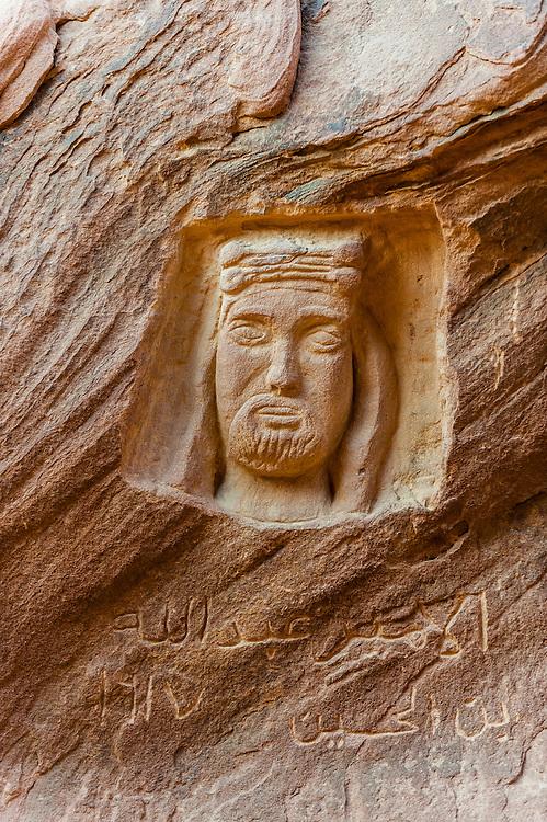 Carving of King Abdullah I carved into a rock in the Arabian Desert at Wadi Rum, Jordan.