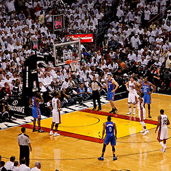 Jun 21, 2012; Miami, FL, USA; Miami Heat shooting guard Dwyane Wade (3) shoots a free throw during the fourth quarter of the 2012 NBA Finals against the Oklahoma City Thunder  at the American Airlines Arena. Miami won 121-106. Mandatory Credit: Derick E. Hingle-US PRESSWIRE
