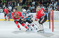 KELOWNA, CANADA - FEBRUARY 8: Cody Fowlie #18 of the Kelowna Rockets attempts to block the pass in front of the net between Mac Carruth #1 and Ty Rattie #8 Portland Winterhawks at the Kelowna Rockets on February 8, 2013 at Prospera Place in Kelowna, British Columbia, Canada (Photo by Marissa Baecker/Shoot the Breeze) *** Local Caption ***