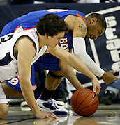 Utah State guard Brian Green, left, and Boise State guard Westly Perryman, right, battle for a loose ball during the first half of an NCAA college basketball game in Logan, Utah, Saturday, Feb. 5, 2011. Utah State defeated Boise State 77-49. (AP Photo/Colin E Braley)