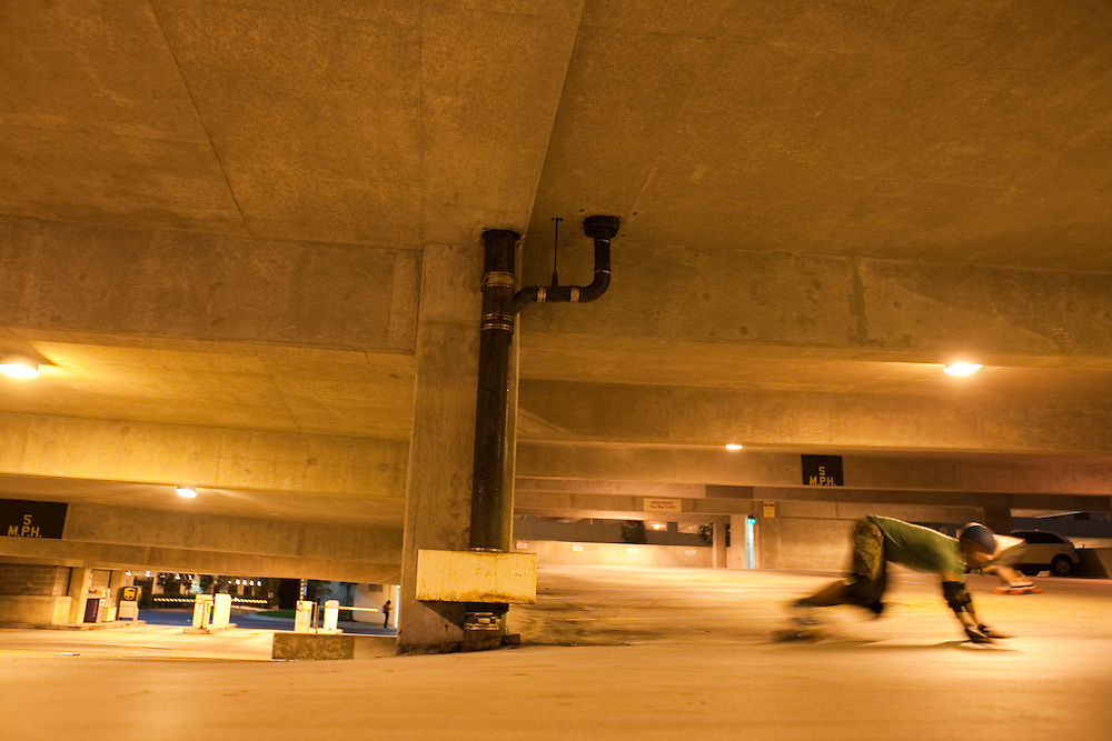Dallas Childers, 42, comes to a sliding stop in a parking garage in Towson on Monday, June 14, 2010.