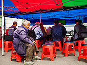 SEOUL, SOUTH KOREA: An elderly woman at a Christian prayer meeting in a tent in front Seoul Station, the main train station for Seoul and the largest train station in South Korea.       PHOTO BY JACK KURTZ