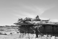 nude woman on a rock formation