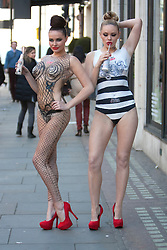 © Licensed to London News Pictures. 16/04/2012. London, U.K..Two models, painted head to foot as Diet Coke contour bottles, to celebrate the launch of the Jean Paul Gaultier for Diet Coke Night & Day collection at Harvey Nichols..Photo credit : Rich Bowen/LNP