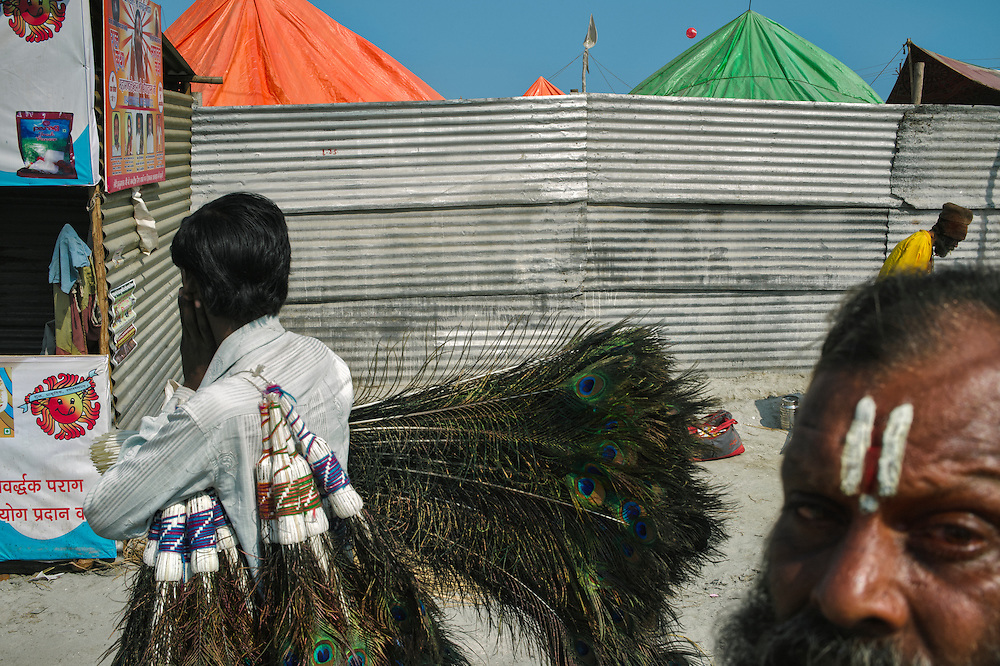 A peacock-feathers seller roaming the streets of Kumbh in Allahabad.