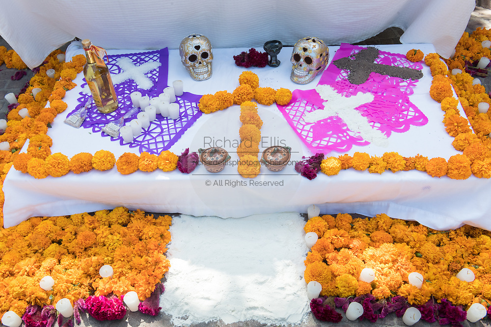An altar known as an ofrenda decorated for Day of the Dead festival in San Miguel de Allende, Guanajuato, Mexico. The week-long celebration is a time when Mexicans welcome the dead back to earth for a visit and celebrate life.