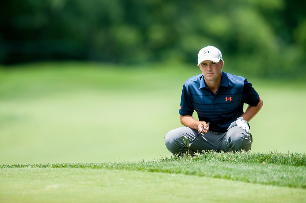 Jordan Spieth reads the break in the green before playing his 3rd shot from a greenside bunker on the 6th hole during the first round of the Quicken Loans National golf tournament on Wednesday at Congressional Country Club in Bethesda, Maryland.
