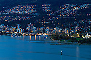 Evening view of Ambleside Park and tall condo/apartment towers along Marine Drive in West Vancouver, British Columbia, Canada.  Photographed from Prospect Point in Vancouver's Stanley Park.
