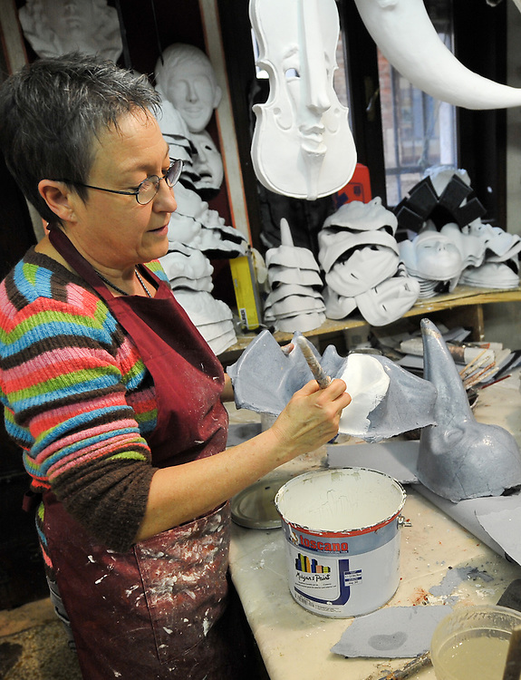 An Artisan at Mascareri paints  a mask in her shop. Artisans, masks and costumes makers are getting ready ahead of Venice Carnival 2013