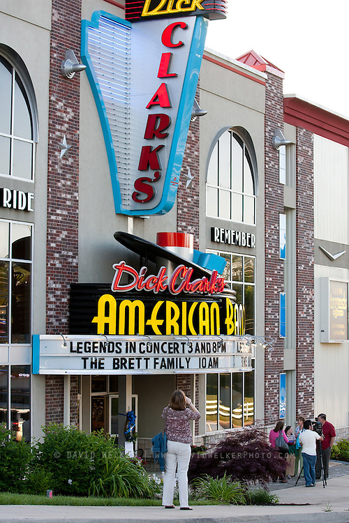 BRANSON, MO - APRIL 18: Carol Johnson from Minnesota takes a picture of the signage prior to a candlelight vigil in honor of Dick Clark at Dick Clark's American Bandstand Theater on April 18, 2012 in Branson, Missouri.  (Photo by David Welker/Getty Images)*** Local Caption *** Carol Johnson.