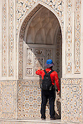 Tourist at Tomb of Etimad Ud Doulah, 17th Century Mughal tomb built 1628, Agra, India