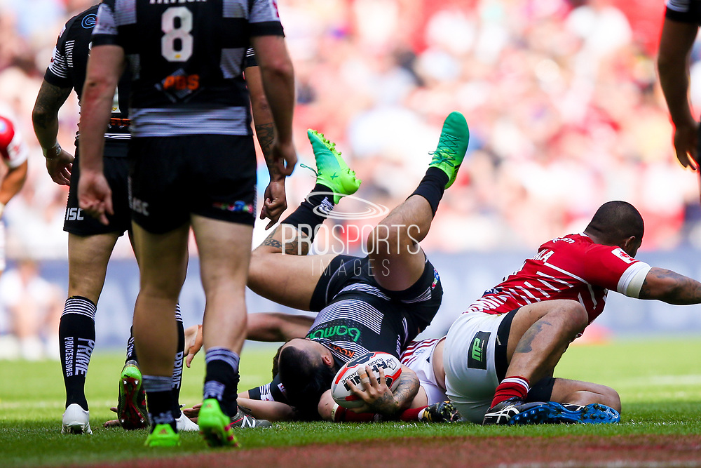 Hull FC right wing Mahe Fonua (2) is upended during the Ladbrokes Challenge Cup Final 2017 match between Hull RFC and Wigan Warriors at Wembley Stadium, London, England on 26 August 2017. Photo by Simon Davies.