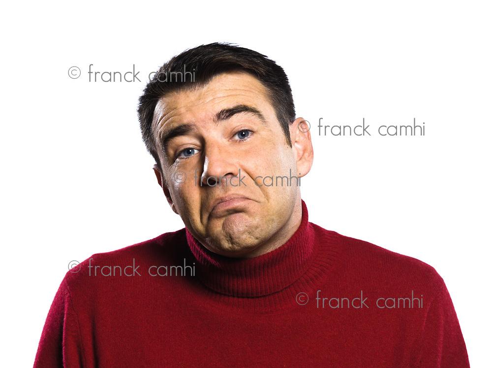 caucasian ignorant man Shrugging pouting puckering studio portrait on isolated white backgound
