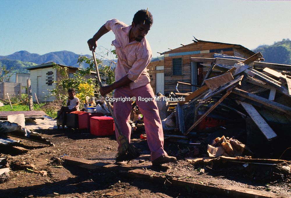 A Kingston resident clears up damage to his home in September 1988 after Hurricane Gilbert hit Jamaica. By the time the destruction had stopped, 45 people were dead and over 500,000 left homeless. Agriculture was devastated, with US$50 million in damage to coffee, sugar cane, banana and other crops. Looting was widespread, particularly in Kingston. Foreign aid of about US$125 million form the USA alone poured into the stricken island. The tourist parts of the island were returned to normal with remarkable speed, but others took much longer to recover from the devastation.