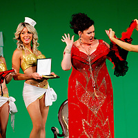 Picture shows : Karen Cargill as Isabella with bunny girls..Picture  ©  Drew Farrell Tel : 07721 -735041..A new Scottish Opera production of  Rossini's 'The Italian Girl in Algiers' opens at The Theatre Royal Glasgow on Wednesday 21st October 2009..(Soap) opera as you've never seen it before.Tonight on Algiers.....Colin McColl's cheeky take on Rossini's comic opera is a riot of bunny girls, beach balls, and small screen heroes with big screen egos. Set in a TV studio during the filming of popular Latino soap, Algiers, the show pits Rossini's typically playful and lyrical music against the shoreline shenanigans of cast and crew. You'd think the scandal would be confined to the outrageous storylines, but there's as much action off set as there is on.... .Italian bass Tiziano Bracci makes his UK debut in the role of Mustafa. Scottish mezzo-soprano Karen Cargill, who the Guardian called a 'bright star' for her performance as Rosina in Scottish Opera's 2007 production of The Barber of Seville, sings Isabella. .Cast .Mustafa...Tiziano Bracci.Isabella..Karen Cargill.Lindoro...Thomas Walker.Elvira...Mary O'Sullivan.Zulma...Julia Riley.Haly...Paul Carey Jones.Taddeo...Adrian Powter. .Conductors.Wyn Davies.Derek Clarke (Nov 14). .Director by Colin McColl.Set and Lighting Designer by Tony Rabbit.Costume Designer by Nic Smillie..New co-production with New Zealand Opera.Production supported by.The Scottish Opera Syndicate.Sung in Italian with English supertitles..Performances.Theatre Royal, Glasgow - October 21, 25,29,31..Eden Court, Inverness - November 7. .His Majesty's Theatre, Aberdeen  - November 14..Festival Theatre,Edinburgh - November 21, 25, 27 ...Note to Editors:  This image is free to be used editorially in the promotion of Scottish Opera. Without prejudice ALL other licences without prior consent will be deemed a breach of copyright under the 1988. Copyright Design and Patents Act  and will be subject to payment or legal action, where appropriate..Further further inf
