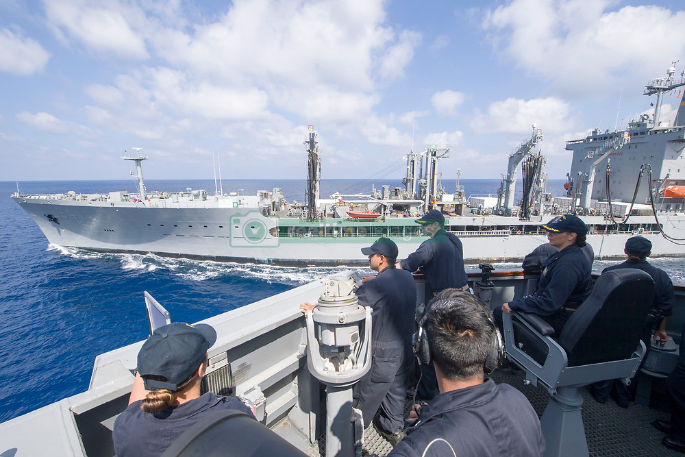 SOUTH CHINA SEA (May 4, 2017) Cmdr. Claudine Caluori, seated, commanding officer of the Arleigh Burke-class guided-missile destroyer USS Sterett (DDG 104), Cmdr. Sean Lewis, executive officer, and the bridge watch team monitor a replenishment-at-sea with Henry J. Kaiser-class fleet replenishment oiler USNS John Ericsson (T-AO 194). Sterett is part of the Sterett-Dewey Surface Action Group and is the 3rd deploying group operating under the command and control construct called 3rd Fleet Forward. (U.S. Navy photo by Mass Communication Specialist 1st Class Byron C. Linder/Released)170504-N-ZW825-221 <br /> Join the conversation:<br /> http://www.navy.mil/viewGallery.asp<br /> http://www.facebook.com/USNavy<br /> http://www.twitter.com/USNavy<br /> http://navylive.dodlive.mil<br /> http://pinterest.com<br /> https://plus.google.com