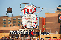 "Minneapolis, USA - July 18, 2011: Minnie and Paul logo in the outfield at Target Field in Minneapolis. A large version of the Twins' original ""Minnie and Paul"" logo (designed by local artist, Ray Barton) stands in center field. It shows two players wearing the uniforms of the two minor-league teams that played in the Twin Cities before the Twins' arrival, the Minneapolis Millers and St. Paul Saints, shaking hands across the Mississippi River. During various points in the game, the strobe lights surrounding the logo flash"