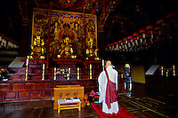 Buddhist monk praying, Singhung-sa Temple, Mt. Soraksan National Park, South Korea