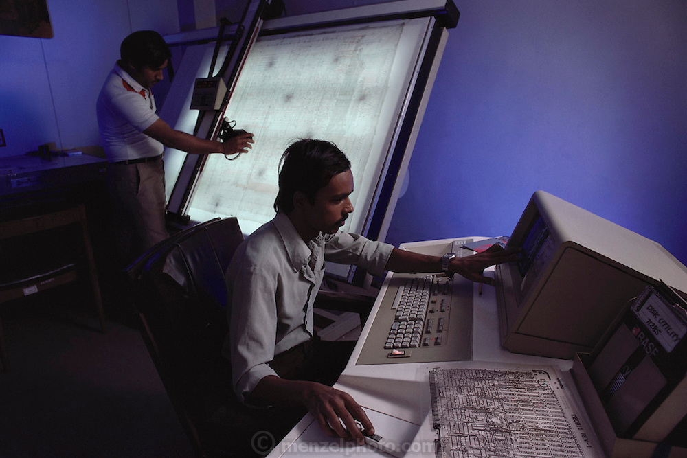DCM Data Products engineers working on computer-designed printed circuit cards, in 1986.  New Delhi, India.