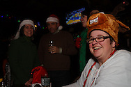 (from right) Megan Barry came down from Cleveland to visit her sister Maureen of Dayton and take part in her sixth Santa Claus Pub Crawl through the Oregon District in downtown Dayton, Saturday, December 11, 2010.  They're seen here at the Dublin Pub.