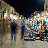 Via Roma, the main road, is crowded with tourists during the summer nights