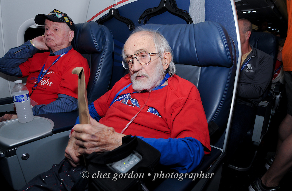 "WWII Veterans and their escorts onboard the Hudson Valley Honor Flight during ""Mail Call"" in Arlington, VA on Saturday, April 11, 2015. Nearly 100 Veterans from the Orange County (NY) region toured the WWII, Korean, Vietnam, and USMC War Memorials, as well as Arlington National Cemetery. Hudson Valley Honor Flight is a chapter of the Honor Flight Network, which provides free flights for WWII Veterans and tours of the WWII Memorial constructed in their honor, and other sites in the nation's capital.  © Chet Gordon for Hudson Valley Honor Flight"