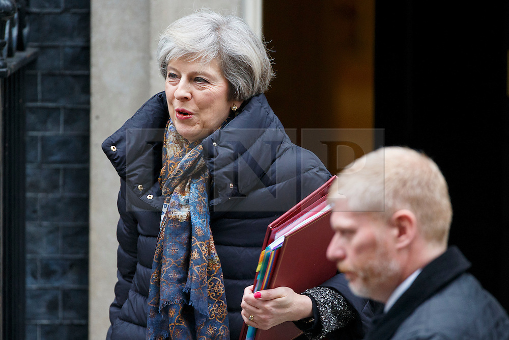 © Licensed to London News Pictures. 25/01/2017. London, UK. Prime Minister THERESA MAY leaves Downing Street to attend Prime Minister's Question Time in House of Commons in London on 25 January 2017. Photo credit: Tolga Akmen/LNP