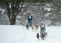 Six dog class competitors Fran Plaisted of Orford and Peter Colbath of Wolfboro head through Laconia Country Club on Friday morning for the 84th Annual Laconia World Championship Dog Sled Derby.   (Karen Bobotas/for the Laconia Daily Sun)