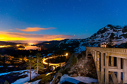 """""""Rainbow Bridge at Donner Lake 3"""" - Photograph shot shortly after sunset of Rainbow Bridge, light trails from a driving car, Donner Lake, and Truckee, California."""