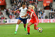 Nikita Parris (7) of England battles for possession with Charlotte Estcourt (17) of Wales during the FIFA Women's World Cup UEFA Qualifier match between England Ladies and Wales Women at the St Mary's Stadium, Southampton, England on 6 April 2018. Picture by Graham Hunt.