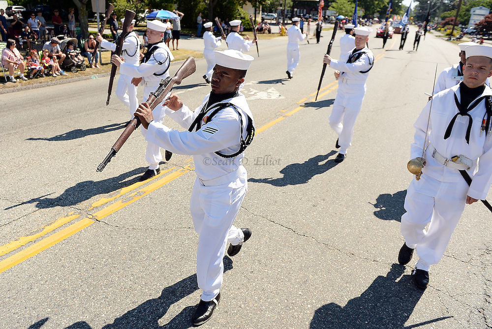 7/4/16 :: REGION :: SMITH :: The U.S. Navy Submarine School Silver Dolphins precision drill team performs in the Groton Independence Day Parade Monday, July 4, 2016. (Sean D. Elliot/The Day)