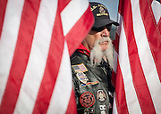 A.C. Scheer, a member of the Patriot Guard stands solemnly during the memorial service and dedication of a monument honoring 12 Army Rangers and Air Force special operations troops who were killed in a helicopter crash during training near Antelope Island 20 years ago, Saturday, Oct. 27, 2012.