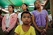 Karen refugee teenagers listen to the sermon during the Revolutionary Day service in Mae La camp.