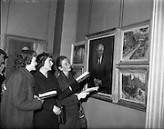 27/04/1959<br /> 04/29/1959<br /> 27 April 1959<br /> Opening day of the R.H.A. Exhibition at the Royal Hibernian Academy, Dublin. Young visitors to the exhibition, Denise Silvester (Dublin); Christinr Roche-Kelly (Limerick) and Catherine Andrews (Dublin) viewing a painting by Mr. Patrick McAvoy, (Iona, Corbally Road, Limerick) at the opening of the exhibition.