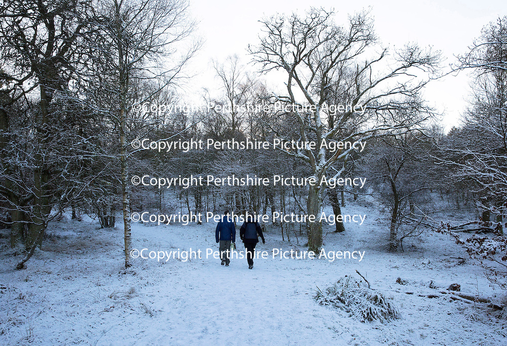 Snow and Ice, Perthshire...28.12.14<br /> A couple make the walk up to the top of Kinnoull Hill in Perth as the freezing conditions bite into another day..<br /> Picture by Graeme Hart.<br /> Copyright Perthshire Picture Agency<br /> Tel: 01738 623350  Mobile: 07990 594431