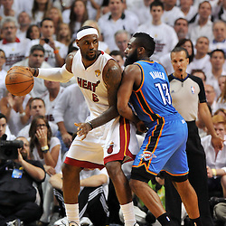 Jun 17, 2012; Miam, FL, USA; Miami Heat small forward LeBron James (6) drives against Oklahoma City Thunder guard James Harden (13) during the first quarter in game three in the 2012 NBA Finals at the American Airlines Arena. Mandatory Credit: Derick E. Hingle-US PRESSWIRE