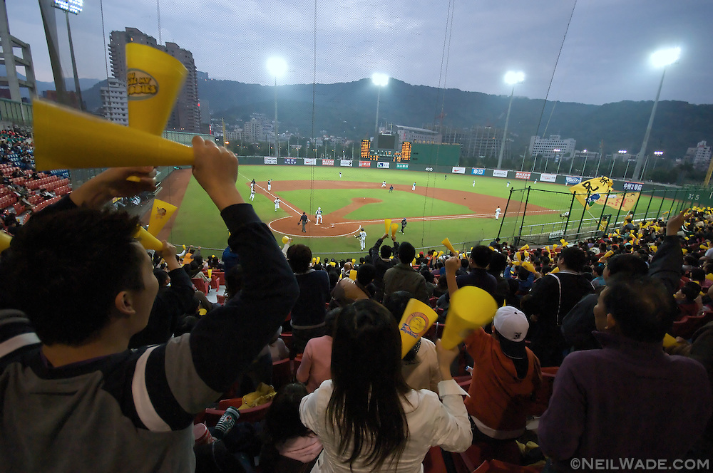 The Taiwanese crowd cheers at the Brother Elephants play the La New Bears in Taiwan Major League Baseball.