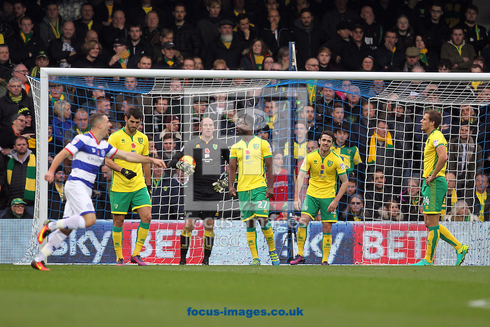 The Norwich players look dejected as goalscorer Sebastian Polter of Queens Park Rangers runs off to celebrate scoring his side&rsquo;s 2nd goal during the Sky Bet Championship match at the Loftus Road Stadium, London<br /> Picture by Paul Chesterton/Focus Images Ltd +44 7904 640267<br /> 19/11/2016