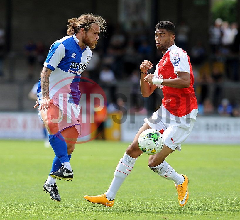 Stuart Sinclair of Bristol Rovers is challenged by Arsenal's Kristopher Da Garcia - Photo mandatory by-line: Neil Brookman/JMP - Mobile: 07966 386802 - 18/07/2015 - SPORT - Football - Bristol - Memorial Stadium - Pre-Season Friendly