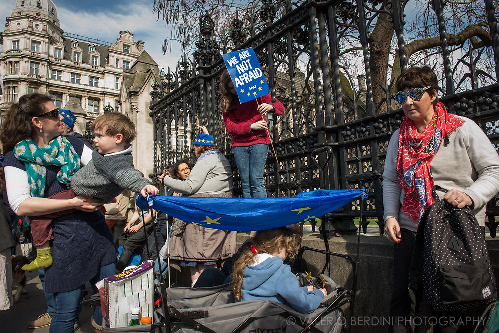 A family attending the March for Europe. Parliament Square, London. UK