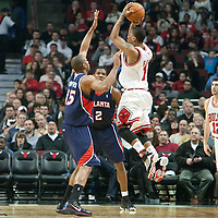 19 December 2009: Chicago Bulls guard Derrick Rose takes a jumpshot over Atlanta Hawks center Al Horford during the Chicago Bulls 101-98 victory in overtime over the Atlanta Hawks at the United Center, in Chicago, Illinois, USA.