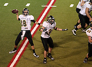 Kennedy's James Lizarraga (18) drops back to pass as Shane Williams (31) blocks during the game between Cedar Rapids Kennedy and Linn-Mar at Linn-Mar Stadium in Marion on Friday evening, September 2, 2011. It was 35-7 Linn-Mar at halftime.