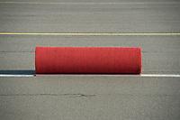 18 JUN 2013, BERLIN/GERMANY:<br /> Der rote Teppich wartet in aufgerolltem Zustand auf die Ankunft von Barack Obama, Praesident USA, auf dem militaerischen Teil des Flughafens Berlin Tegel, Besuch des Praesidenten der Vereinigten Staaten von AmerikaIMAGE: 20130618-01-001<br /> KEYWORDS: Präsident U.S.A., Staatsgast